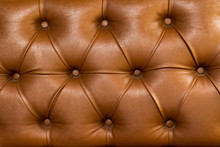 Brown Leather Upholstery Chair With Buttons Pattern Background. Dark Brown Vintage Sofa Elegant Leather With Buttons Texture Surface