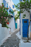 Fototapeta Uliczki - Picturesque scenic narrow streets with traditional whitewashed houses with blue doors windows of Mykonos Chora town in famous tourist attraction Mykonos island, Greece