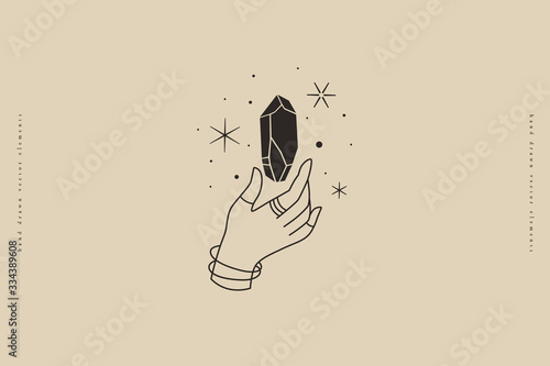 Fototapeta Magic quartz stone sparkles and soars above the hand