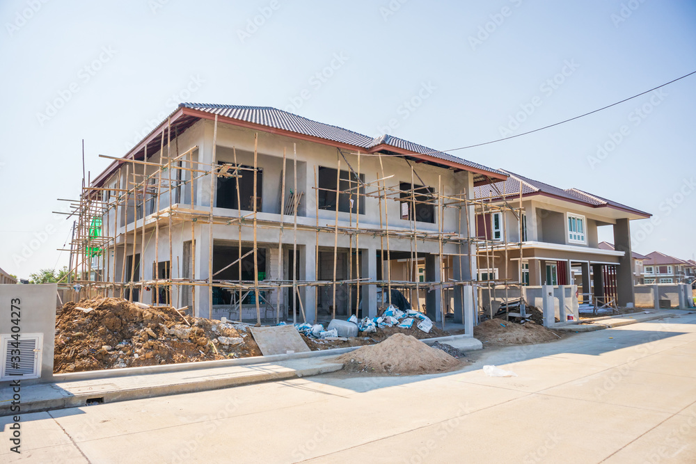 Fototapeta New residential house contemporary style building in progress at construction site