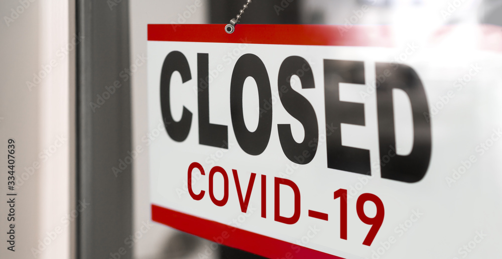 Fototapeta Closed businesses for COVID-19 pandemic outbreak, closure sign on retail store window banner background. Government shutdown of restaurants, shopping stores, non essential services.