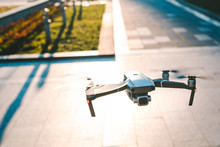 Flying Drone With The City In ...