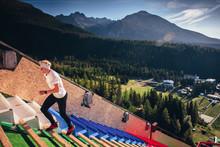 Athlete Run Up Stairs On Ski J...