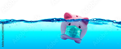 Fototapeta Piggy bank Wearing A Protective Face Mask Drowning In Underwater - Protection Concept And Savings To Risk obraz