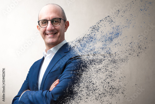 smiling businessman dissolving in the air