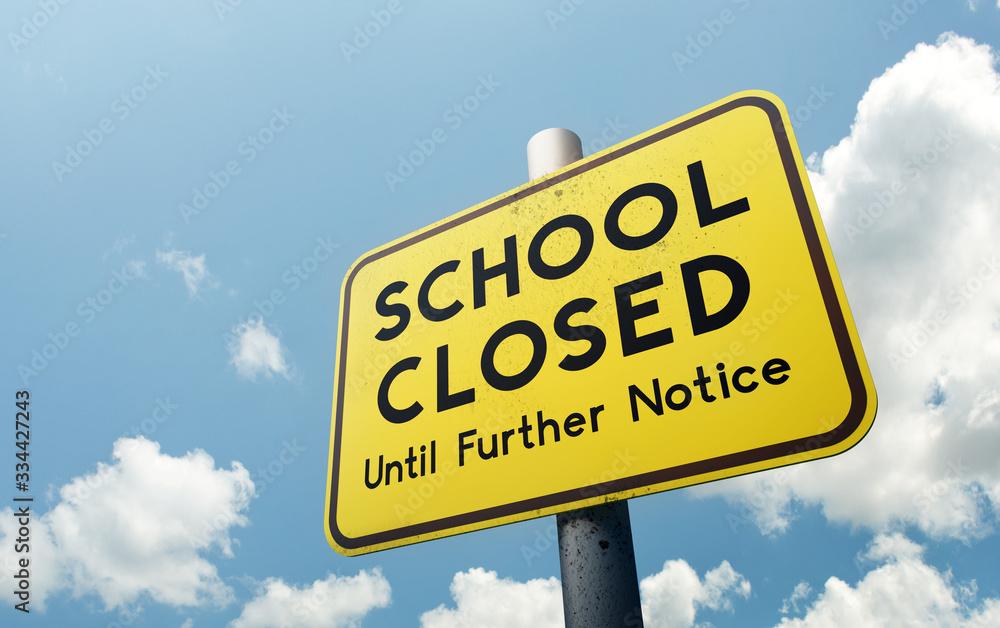 Fototapeta A school closed until further notice public road sign. Schools closing globally due to Covid-19 coronavirus. 3D illustration.