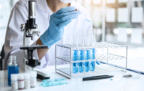 Fotografia Biochemistry laboratory research, Scientist or medical in lab coat holding test