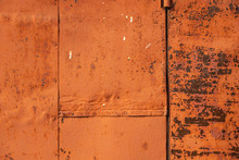 Metallic Rusty Orange Wall With Peeling Paint. Background Texture