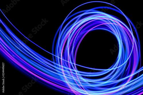 Light painting photography, long exposure photo of purple and blue streaks of vi Slika na platnu