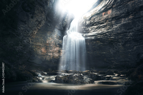 Fotografiet Waterfall in a cave in a mysterious environment