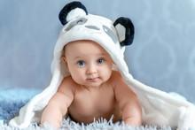 A Newborn Baby Is Resting In B...