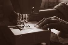 Sewing Machine And Old Grandmo...