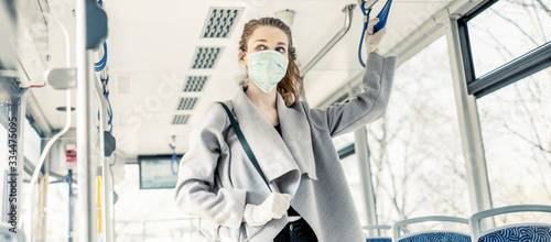 Fototapeta Woman wearing surgical protective mask in a public transportation obraz
