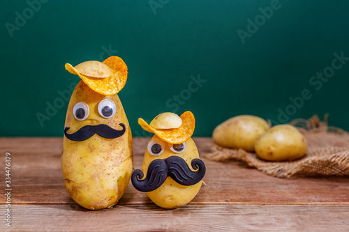 funny potato head with face on wooden background Canvas Print