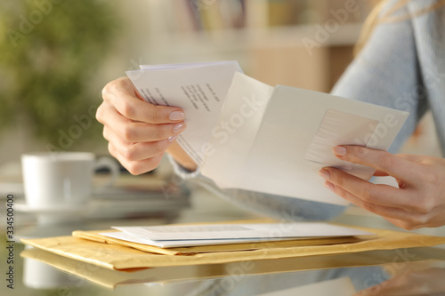 Girl hands opening an envelope on a desk at home Tapéta, Fotótapéta