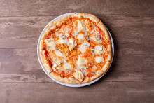 Details Of Fresh Four Cheese Pizza On Wooden Background