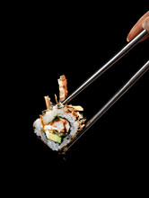 Japanese And Asian Cuisine Sushi Rollin Chinese Chopsticks With Fresh Ingredients Over Black