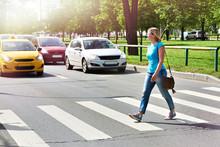 Woman Crossing Street At Cross...