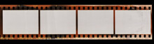 Start Of 35mm Negative Film Strip With Empty Cells, Real Scan Of Film Material With Cool Scanning Light Interferences On The Material.