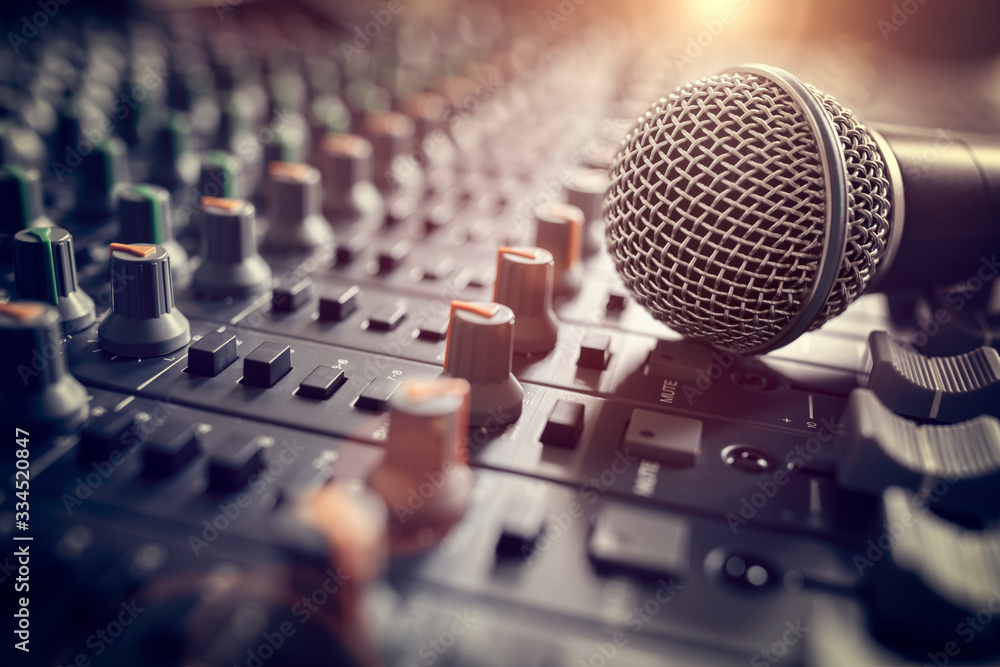 Fototapeta Sound recording studio mixing desk with microphone on mixer