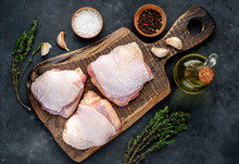 Raw Chicken Thighs With Spices On A Stone Background