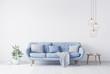 Leinwanddruck Bild - grey pillow above blue Scandinavian sofa in modern interior. wooden side table with gold elegant accessories. Green plant vase. White wall mock up. Minimal concept design. 3D render. 3D illustration