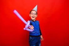 Cheerful Boy In A Festive Cap ...