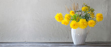 Yellow Summer Flowers In Jug On White Background