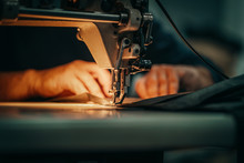 Sewing Machine And Men's Hands...