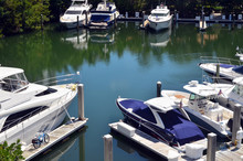 Boats Docked At A Small Marina
