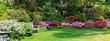 Leinwandbild Motiv Beautiful Garden with blooming trees during spring time, Wales, , banner size