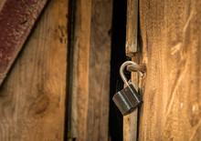 Open Padlock On The Door