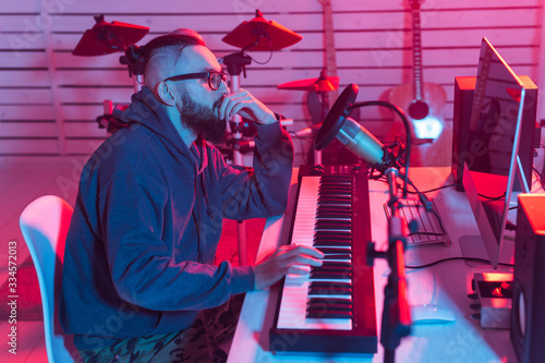 Fotografie, Obraz Male sound producer working in recording studio.