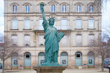 Small Copy Of The Statue Of Liberty In Front Of The Building
