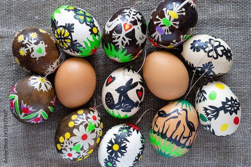 Obraz na płótnie Modern colored Easter eggs according to Lithuanian tradition on a linen fabric b