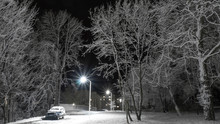 Snow-covered Alley With Car An...