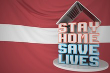 Portable Computer And STAY HOME SAVE LIVES Inscription With Flag Of Latvia As A Background. Latvian COVID-19 Outbreak Self-isolation. 3D Rendering