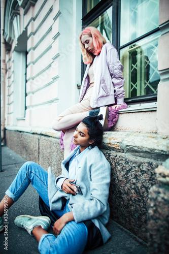 Two teenage girls infront of university building smiling, having fun, lifestyle Tapéta, Fotótapéta