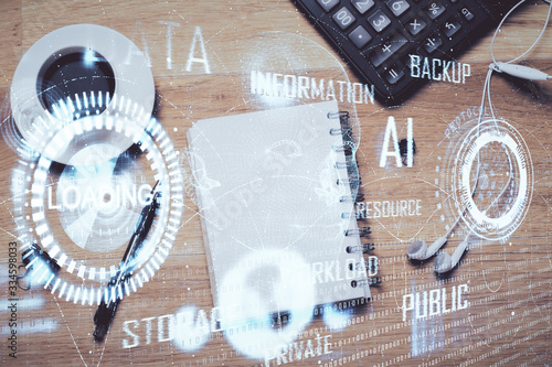 Double exposure of technology theme drawing over work table desktop. Top view. Global data analysis concept.