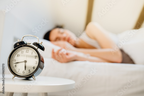 Obraz Alarm clock ringing.Woman waking up in early morning for work.Obstructive sleep apnea effects.Mental stress sleep depression.Melatonin deficiency.Narcolepsy.Burn out syndrome,overworked parent - fototapety do salonu