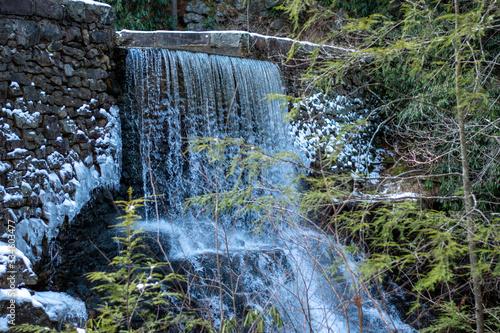 a beautiful winter waterfall in the mountain