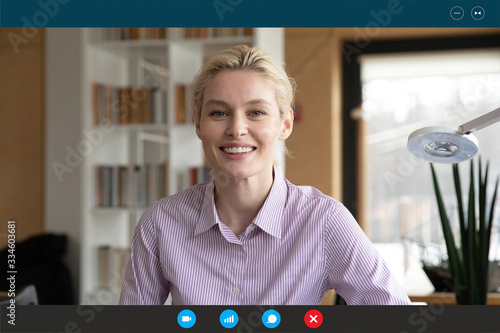 Headshot portrait screen application view of smiling young woman consultant spea Canvas Print