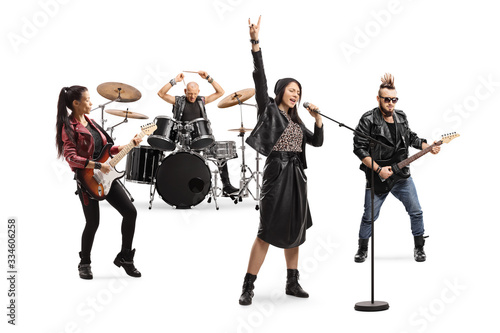 Stampa su Tela Female singer, male and female guitar players and a drummer in a band