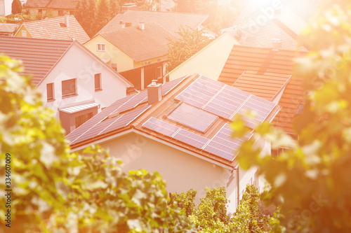 Solar panels on the tiled roof of the building in the sun Canvas Print