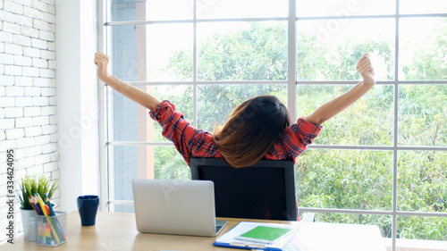 Work from home, Stretch for relax, Young asian woman stretching body while worki Canvas Print