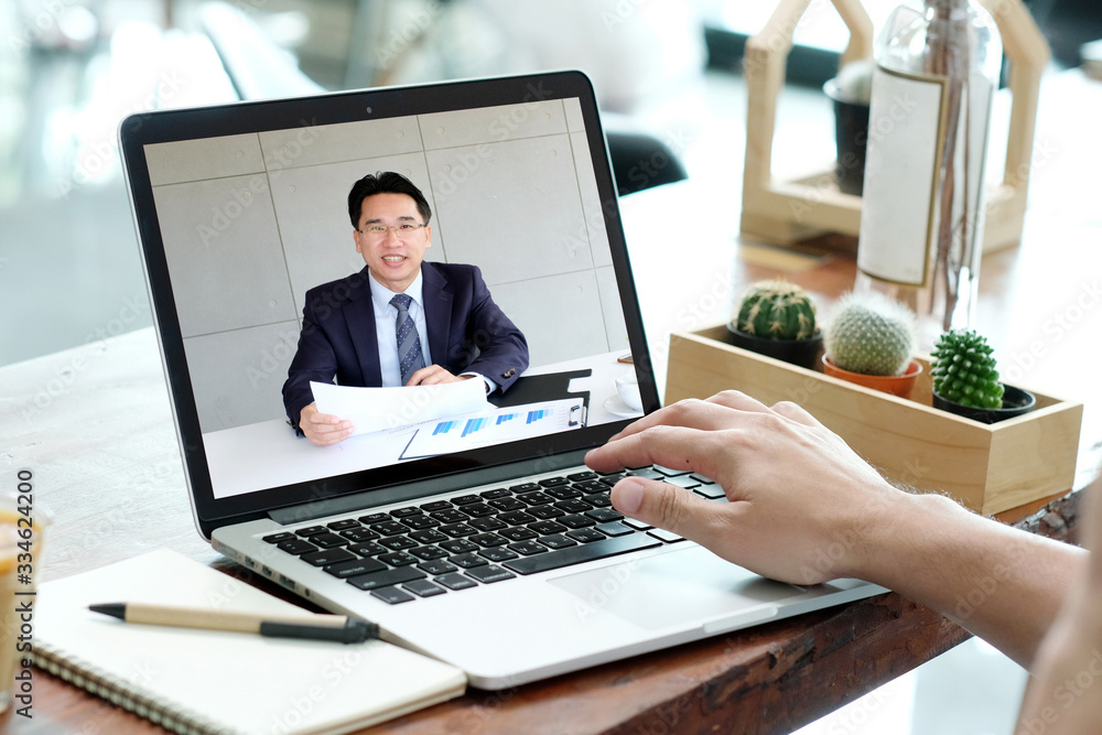 Fototapeta Video conference, Work frome home, Businessman making video call to employee with virtual web, Contacting manager by conference on laptop computer at home, Talking on webcam, Online consultation, HR