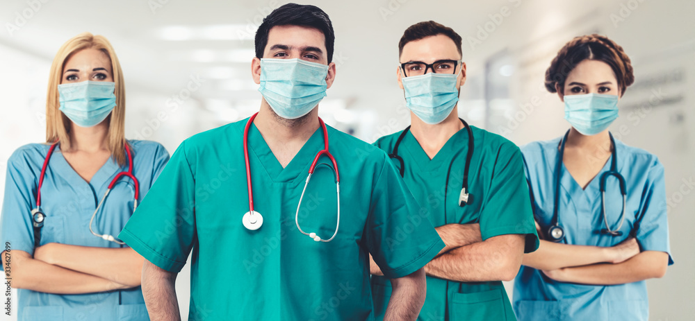 Fototapeta Doctor at hospital wearing medical mask to protect against coronavirus 2019