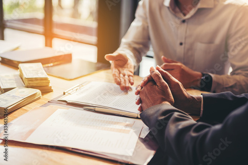 Fototapeta businessman reading documents at meeting, business partner considering contract terms before signing checking legal contract law conditions obraz