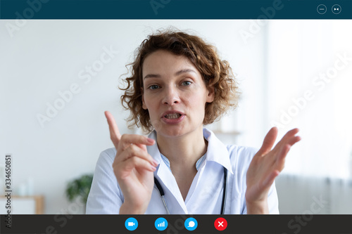 Fototapeta Headshot portrait application screen view of middle-aged female doctor or GP talk consult client online on computer, woman nurse speak with sick patient on video call use Webcam conference on laptop obraz