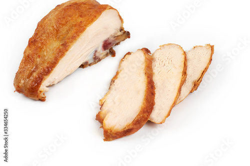 Fototapeta A close up of grilled, sliced chicken breast isolated on white background . obraz